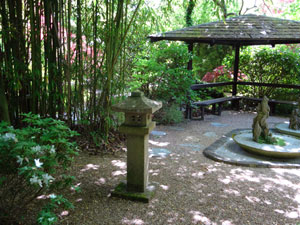 Picture of landscaped oriental gardens with bamboo, rocks, gravel and wooden shelter