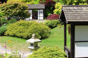 Image of Japanese garden with tea house and similar 'waiting arbour' building